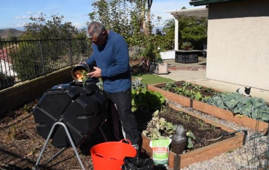 feeding a tumbling composter